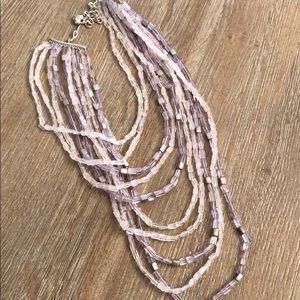 Beautiful 10 strand amethyst colored bib necklace.